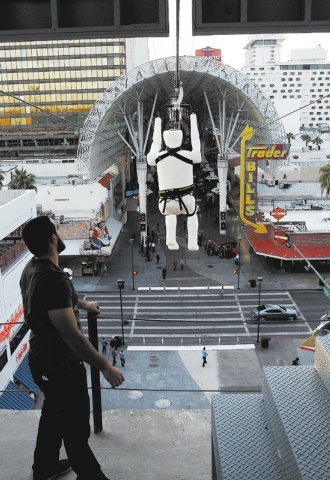 A test dummy named Fred is monitored by Supervisor of Operations Brian Altmann during a test run of the yet to be opened Slotzilla zip line above the Fremont Street Experience in Las Vegas on Dec. ...