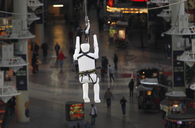 A test dummy named Fred is the first to experience the yet to be opened Slotzilla zip line during a test run above the Fremont Street Experience in Las Vegas on Dec. 17, 2013. (Jason Bean/Las Vega ...