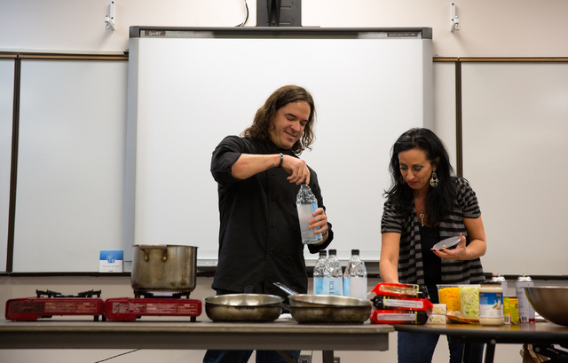 Todd English P.U.B. executive chef Jean Paul Labadie, left, is assisted by Carol Lanata during a food demonstration for juniors at Cimarron-Memorial High School, 2301 N. Tenaya Way, Nov. 26. Commu ...