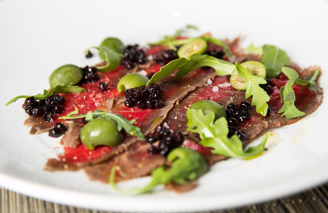 Buffalo carpaccio with huckleberries, green olives, wild arugula, sea salt and olive oil is available at Tom Colicchio's Heritage Steak restaurant. (Samantha Clemens/Las Vegas Review-Journal)
