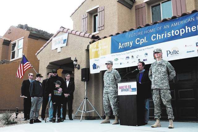 Stephen Page, right, director at Operation Finally Home, speaks during a ceremony dedicating a new home to Army veteran Christopher Bales in southwest Las Vegas, Jan. 23. To read Bales story, visi ...