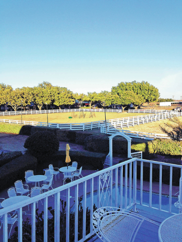 Corrals at Southfork Ranch are shown in this view from the home's sweeping second-floor balcony.  (ED GRANEY/LAS VEGAS REVIEW-JOURNAL)
