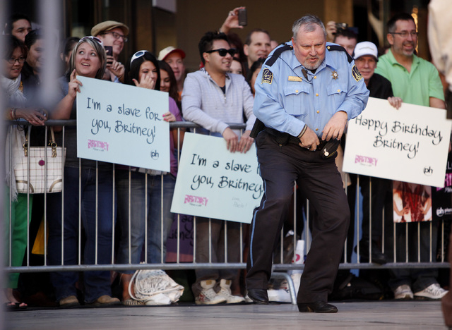A security guard dances before the arrival of Britney Spears at Planet Hollywood in Las Vegas Tuesday, Dec. 3, 2013. (John Locher/Las Vegas Review-Journal)