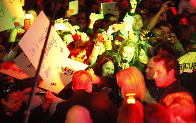 Fans try to catch a glimpse of Britney Spears at Planet Hollywood in Las Vegas Tuesday, Dec. 3, 2013. (John Locher/Las Vegas Review-Journal)