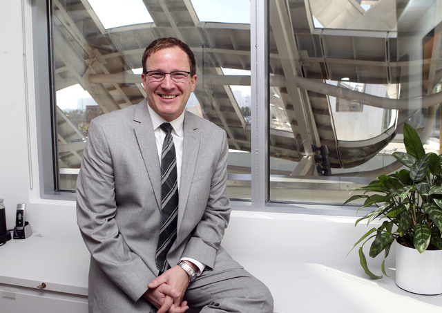 Neurologist Gabriel C. Léger poses in his office at the Lou Ruvo Center for Brain Health in Las Vegas, Monday, Nov. 18, 2013. (Jerry Henkel/Las Vegas Review-Journal)