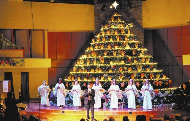 "A choir sings during last year's performance of ""The Living Christmas Tree"" at the Community Lutheran Church, 3720 E. Tropicana Ave. This year's performance is scheduled for 7 p.m. Dec. 5-7 and 2  ..."