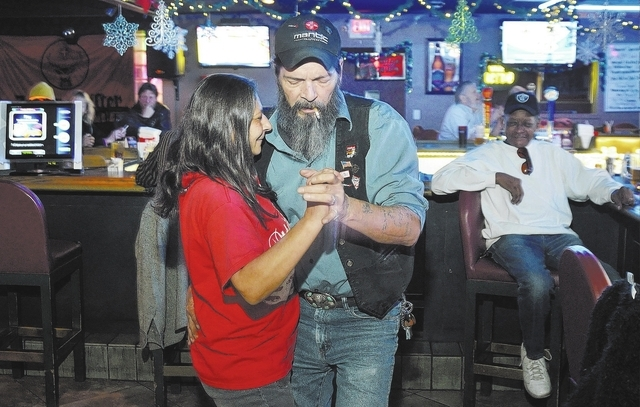 """Natalie and Robin """"Tennessee"""" Horton dance at Double Shots Bar, 3430 E. Tropicana Ave. The 28-year-old venue hosts karaoke nights and weekly trivia and open mic comedy events. (Bill Hughes/View)"""