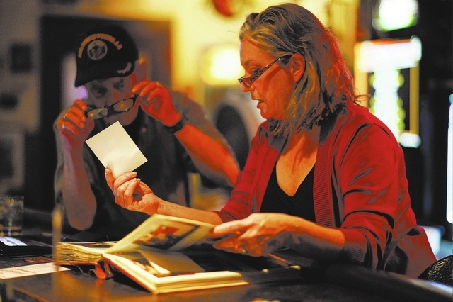 Jack's Place co-owner Corinne Vaughn holds a photo for longtime customer Bill Curnutte. The neighborhood bar, 5067 E. Bonanza Road, was named for Sen. Jack Regan and caters to military veterans. ( ...