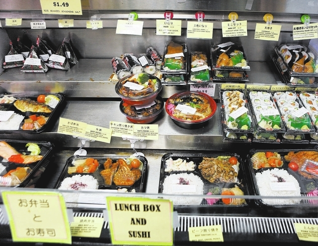 Eco-friendly bento boxes are filled with food at Japan Creek Market, 9310 S. Eastern Ave. (Ronda Churchill/View)