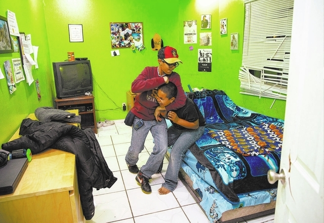 Brothers Justice and Synsyre Newell wrestle at their Las Vegas home. (Samantha Clemens/View)