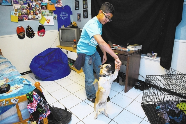 Justice Newell dances with his dog Izzy at his Las Vegas home. (Samantha Clemens/View)
