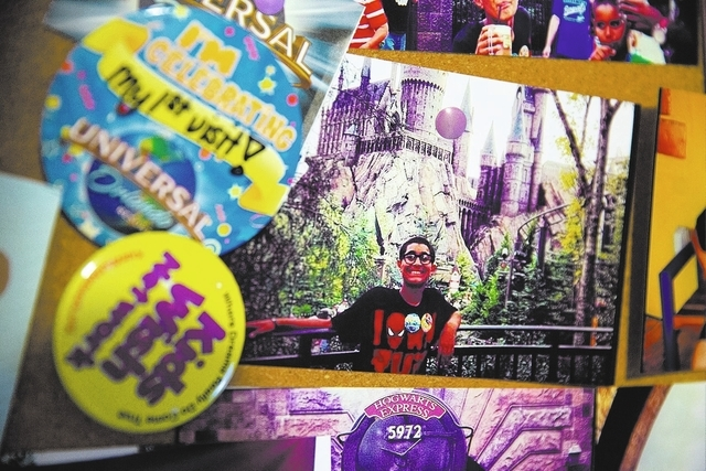 A memory board with photos of Justice Newell and his family at Universal Orlando's Wizarding World of Harry Potter hangs in his room. (Samantha Clemens/View)