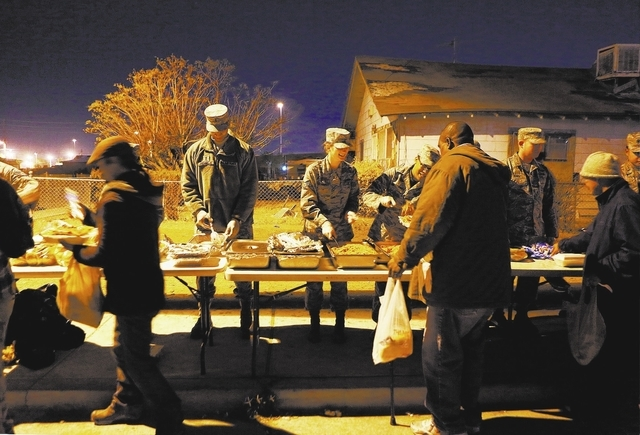 Nellis Air Force Base squadron members feed the homeless and others in need Nov. 25 on the corner of McWilliams Avenue and G Street. (Ronda Churchill/View)