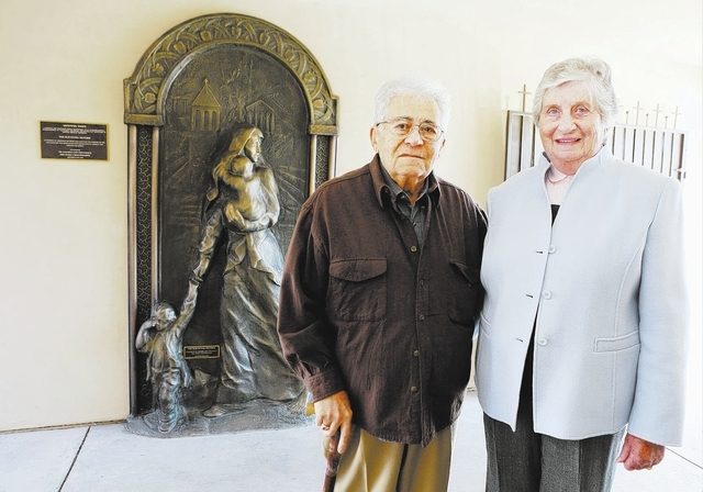 "Gary Deratzou and his wife, Doris, stand near an 8-foot-by-4-foot statue titled ""The Surviving Mother"" at St. Garabed Armenian Apostolic Church of Las Vegas, 2054 E. Desert Inn Road. The bronz ..."
