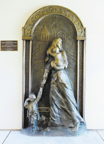 """An 8-foot-by-4-foot statue titled """"The Surviving Mother"""" is displayed in the courtyard at St. Garabed Armenian Apostolic Church of Las Vegas, 2054 E. Desert Inn Road. The bronze statue honors  ..."""