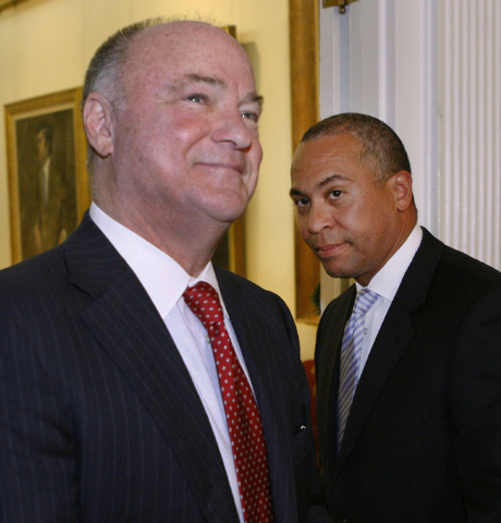 FILE - In this Dec. 13, 2011 file photo, Massachusetts Gov. Deval Patrick, right, and Stephen Crosby leave a news conference at the Statehouse in Boston. Patrick appointed Crosby as chair of a sta ...