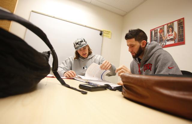Senior and UNLV Baseball player Robert Johnson, center, helps tutor senior Runnin' Rebels basketball player Carlos Lopez-Sosa for a final exam in Fundamentals of College Mathematics at the Academi ...