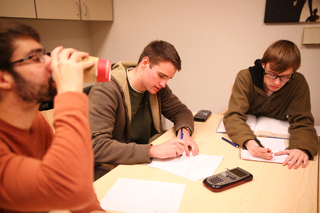 Tutor and mechanical engineering student Jonathan Wright, center, goes over a Calculus 3 problem with sophomore Zakai Olsen, left, and sophomore Luke Olsen at the Academic Success Center at the Un ...