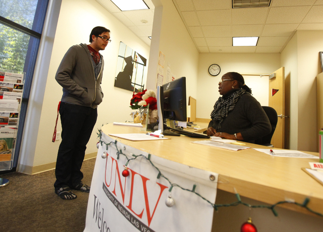 Dominic Hsie, left, talks with administrative assistant Cassandra Bryant about returning for the spring semester at the Academic Success Center at the University of Nevada, Las Vegas on Wednesday, ...
