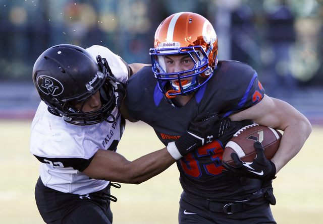 Johnathan Shumaker, right, of Bishop Gorman runs by Calvin Beaulieu of Palo Verde during the Sunset Region championship football game at Bishop Gorman High School in Las Vegas Saturday, Nov. 30, 2 ...