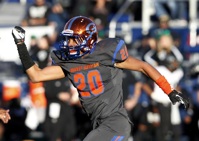 Jabari Butler of Bishop Gorman celebrates after recovering a fumble against Palo Verde during the Sunset Region championship football game at Bishop Gorman High School in Las Vegas Saturday, Nov.  ...