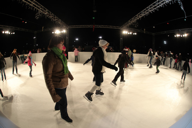 Sunset Park visitors skate on the plastic ice skating rink during a pre-opening at Sunset Wonderland, Dec. 5, 2013.  (Special to View)