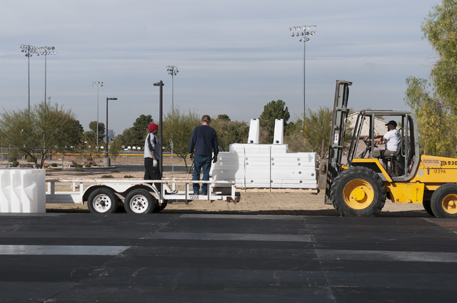 Construction workers unload materials for an ice skating rink at Sunset Park, 2601 E. Sunset Road, in Las Vegas, Tuesday, Dec. 3, 2013. The park is hosting Sunset Wonderland through Dec. 22. (Sand ...