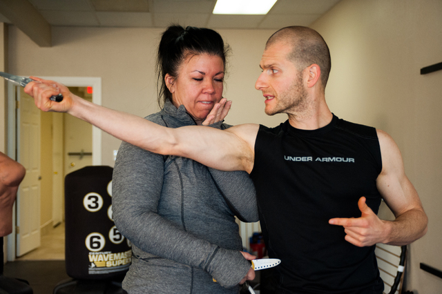Cultural Arts Training Foundation Executive Director Lance Parvin, right, teaches self defense to Sharon Chayra, at the C.A.T. Foundation in Las Vegas Tuesday, Dec. 10, 2013. (Martin S. Fuentes/La ...