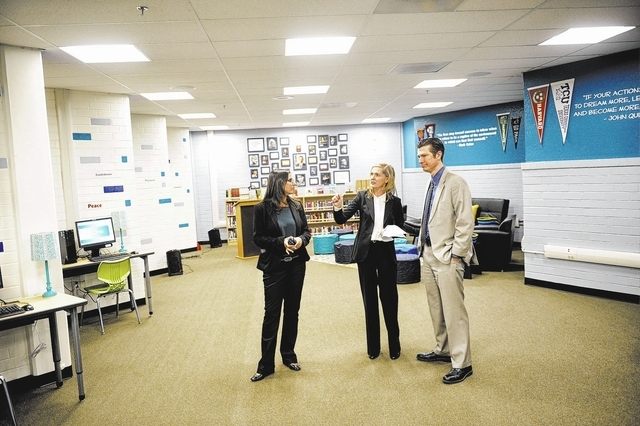 From left, Assistant Principal Gena Reagh, Principal Jill Pendleton, and Chief Student Achievement Officer Dr. Mike Barton, take a tour at the Clark High School Library in Las Vegas on Tuesday, No ...