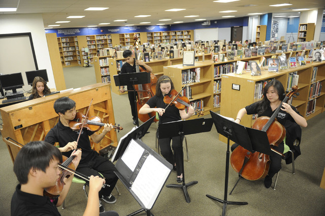 The Clark High School chamber crchestra performs at the school's library in Las Vegas on Tuesday, November 12, 2013. Clark High School received a grant from Capitol One and the Heart of America Fo ...