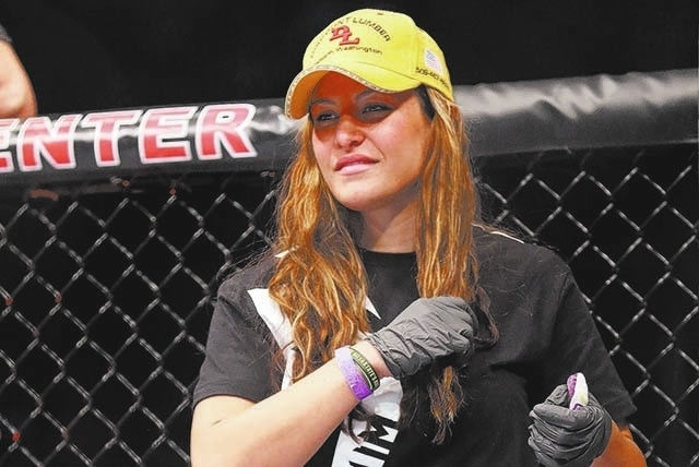 Miesha Tate is seen at Bryan Caraway's UFC 159 Mixed Martial Arts bout against Johnny Bedford in Newark, NJ, Saturday, April 27,2013.  Caraway won via third round submission via choke. (AP Photo/G ...