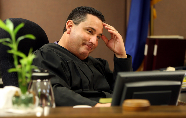 JOHN GURZINSKI/REVIEW-JOURNAL Family Court Judge William Voy listens to a teenaged girl's testimony in his courtroom on Wednesday, March 26, 2008, during her hearing in connection with prostitutio ...