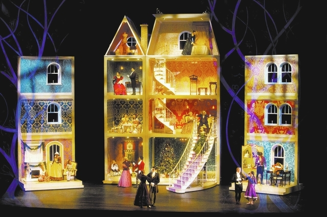 A four story tall dollhouse set of Nevada Ballet Theatre's Nutcracker is shown, including the Nanny on the top fourth floor.