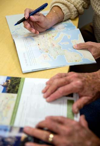 Gene and Dee Tress look over European river cruise options at Expedia Cruise Ship Centers on Thursday, Dec. 12, 2013 at the 1930 Village Center Circle office. The brick and mortar travel agency re ...
