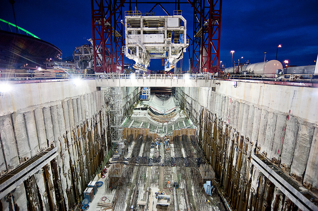 A section of the SR 99 tunneling machine's trailing gear is lowered into the pit where tunneling will start this summer. Bertha, the tunneling machine, was stopped in its tracks by a mysterious  ...