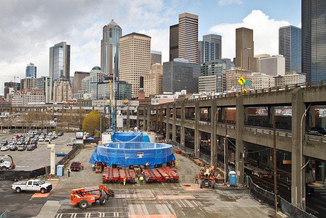 Pieces of Bertha, the SR 99 tunneling machine, sit on a closed portion of Alaskan Way, awaiting reassembly in an 80-foot-deep pit to the west of Seattle's stadiums. Bertha was stopped in its tra ...