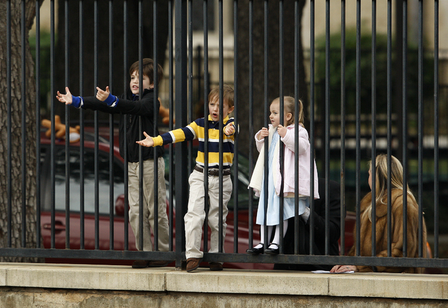 Children watch through a fence as UNLV practices at Southern Methodist University in Dallas, Tex. Sunday, Dec. 29, 2013. The football team is in Dallas to prepare for the Heart of Dallas Bowl on J ...