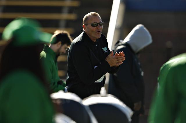 North Texas coach Dan McCarney warms his hands during practice Monday at Highlander Stadium in Dallas. Powered by a resurgent defense that ranks ninth nationally by allowing 18.1 points per game,  ...