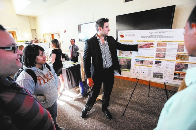 """Ben Green of the """"Vegas Valley Rim"""" project talks about it to attendees during the Senior Design Competition at the Foundations Building at the University of Nevada, Las Vegas on Thursda ..."""