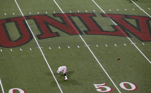 A UNLV football player warms up before their game against San Diego State at Sam Boyd Stadium in Las Vegas Saturday, Nov. 30, 2013. (John Locher/Las Vegas Review-Journal)