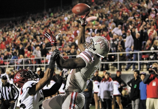 UNLV player Devante Davis catches a pass in the end zone for his first touchdown of the night against The Aztecs at Sam Boyd Stadium in Las Vegas Saturday, Nov. 30, 2013. (John Locher/Las Vegas Re ...
