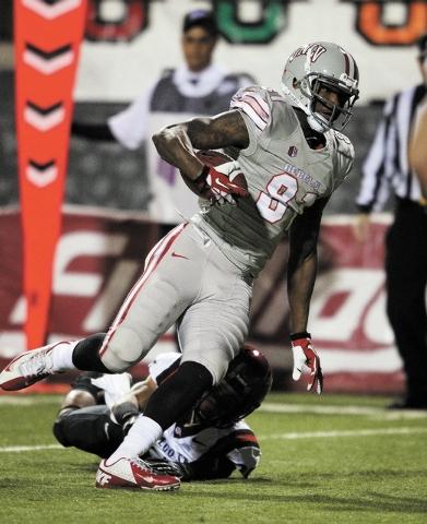 UNLV player Devante Davis breaks a tackle before running into the end zone for a touchdown against the Aztecs at Sam Boyd Stadium in Las Vegas Saturday, Nov. 30, 2013. (John Locher/Las Vegas Revie ...