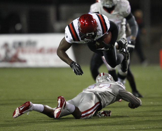 UNLV player Kenneth Penny tackles Ezell Ruffin of the Aztecs during their game at Sam Boyd Stadium in Las Vegas Saturday, Nov. 30, 2013. (John Locher/Las Vegas Review-Journal)