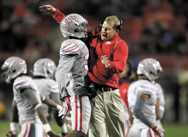 UNLV head coach Bobby Hauck chest bumps player Mike Horsey after UNLV stopped an Aztec first down at Sam Boyd Stadium in Las Vegas Saturday, Nov. 30, 2013. (John Locher/Las Vegas Review-Journal)