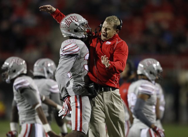 UNLV junior safety Mike Horsey, shown Nov. 30 with coach Bobby Hauck during the Rebels' 45-19 victory over San Diego State, has 4½ tackles for loss, three pass breakups and one interception thi ...