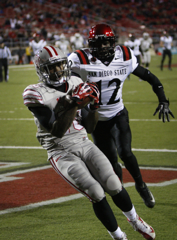 UNLV player player Marcus Sullivan catches a pass in the end zone for a touchdown against Malik Smith of the Aztecs at Sam Boyd Stadium in Las Vegas Saturday, Nov. 30, 2013. (John Locher/Las Vegas ...