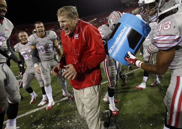 UNLV players dump ice water on head coach Bobby Hauck after they defeated San Diego State at Sam Boyd Stadium in Las Vegas Saturday, Nov. 30, 2013. (John Locher/Las Vegas Review-Journal)