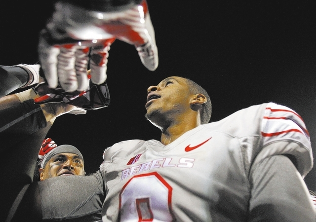 UNLV quarterback Caleb Herring celebrates Saturday after defeating the San Diego State Aztecs at Sam Boyd Stadium. (John Locher/Las Vegas Review-Journal)