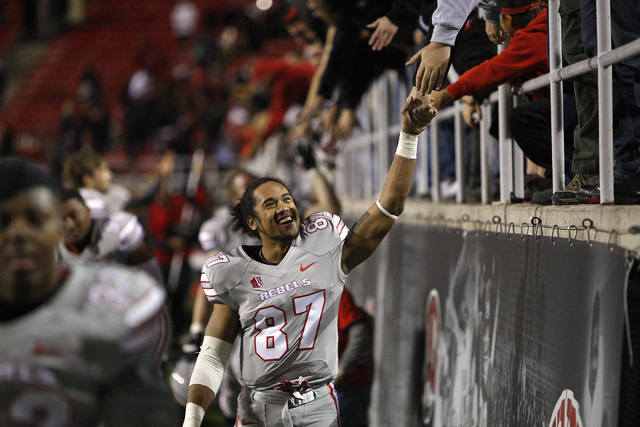 UNLV senior wide receiver Maika Mataele, shown Nov. 30 after the Rebels' 45-19 victory over San Diego State, has 35 receptions for 403 yards and three touchdowns this season. (John Locher/Las Ve ...