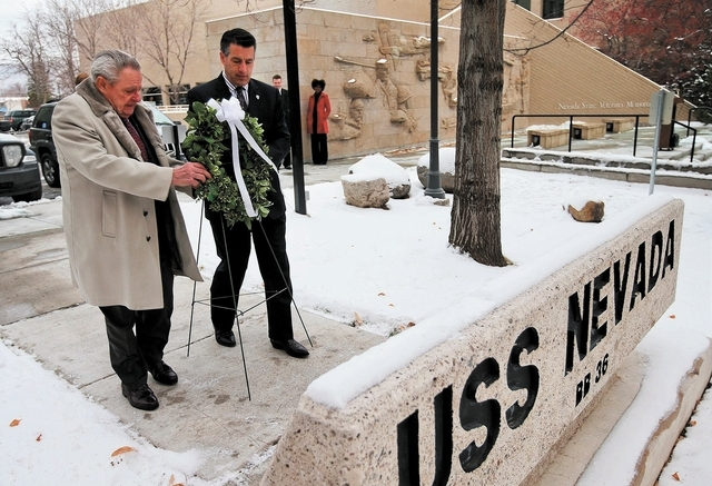 Chuck Harton, left, of the Navy League Reno Council and Gov. Brian Sandoval lay a wreath on the USS Nevada memorial Friday in Carson City. (Cathleen Allison/Las Vegas Review-Journal)